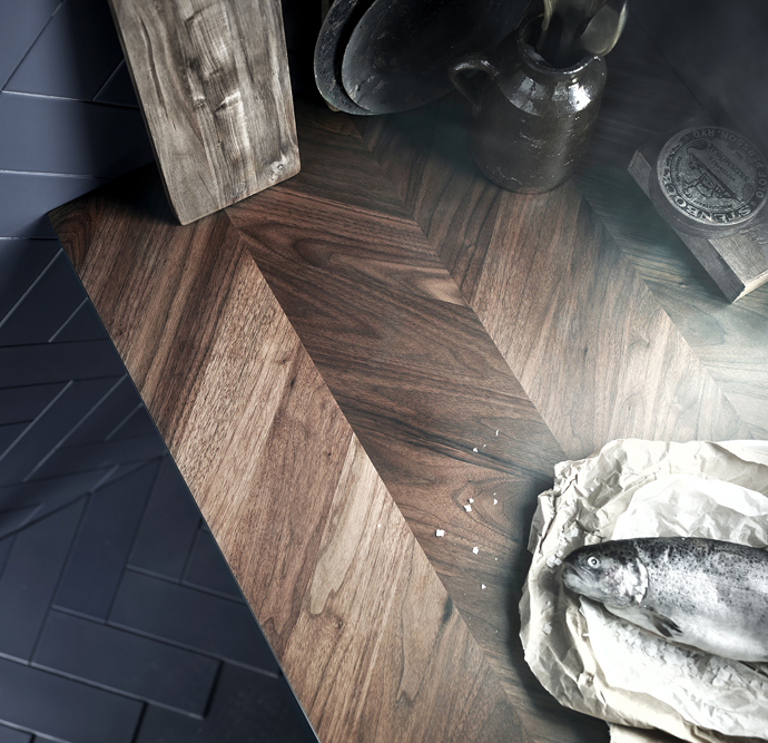 The most beautiful kitchen counter you have ever seen. Herringbone pattern and dark wood by Ikea.