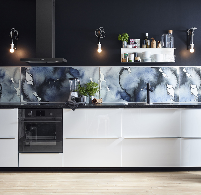 Moody and cosy kitchen design with water colour splash back by Ikea.